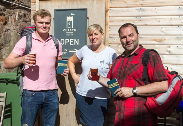 Cheers! Free beer for passport carrying walkers