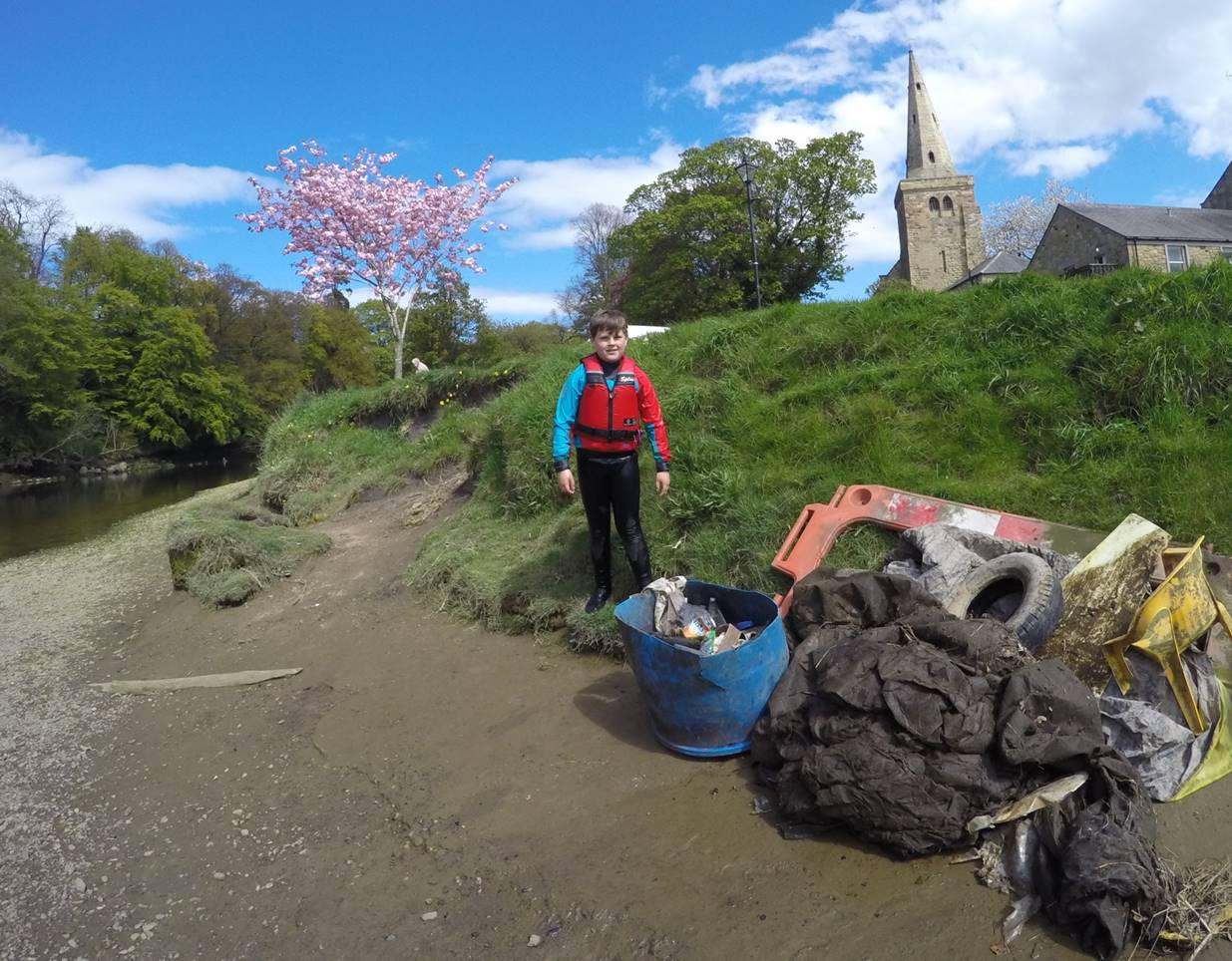 Litter picking  on the River Coquet